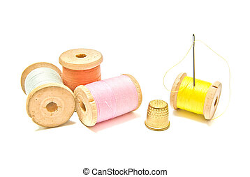 spools of thread with thimble