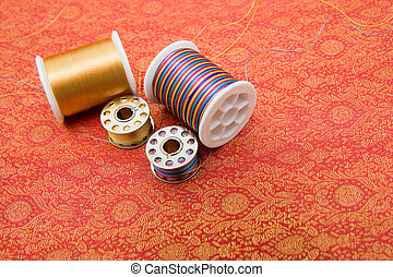 Spools on fabric