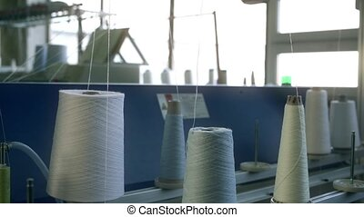 Spools with white thread at rewinding machine video - Big...
