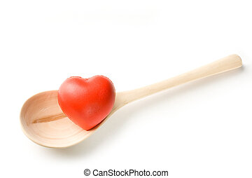 Spoon and heart on white background