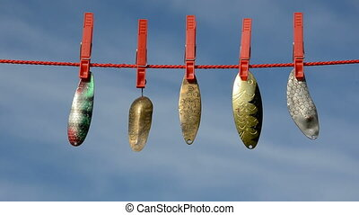 spoon-baits on clothes-line and sky - five vintage...
