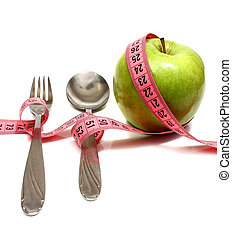 spoon fork and apple is strung by a ribbon for measuring diet