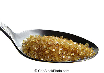 Spoon full of brown cane sugar on white