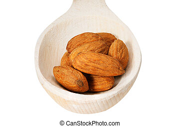 Spoon full of peanuts isolated over the white background