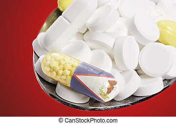 Spoon full of pills and a capsule with the flagdesign of American Samoa.(series)