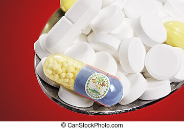 Spoon full of pills and a capsule with the flagdesign of Belize.(series)