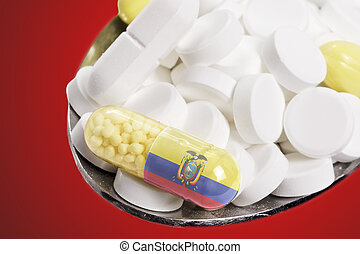 Spoon full of pills and a capsule with the flagdesign of Ecuador.(series)