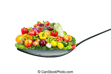 Spoon full of various fruit and vegetables isolated on white