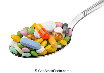 Spoon of drugs - Spoon full of various colorful drugs ...