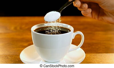 Spoon of sugar poured into coffee cup 4k