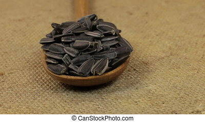 spoon rotation with a pile of sunflower seeds lying on...