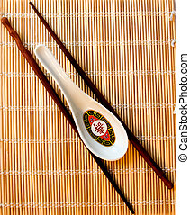 Spoon & Stick - A soup spoon and chopsticks on bamboo used ...