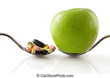 Spoon with apple vs spoon with pills.