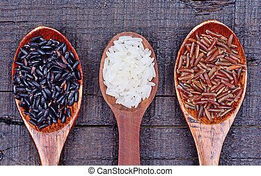 Spoon with different types of rice