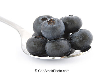 Spoon with fresh blueberries