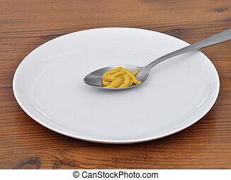 Spoon with mustard