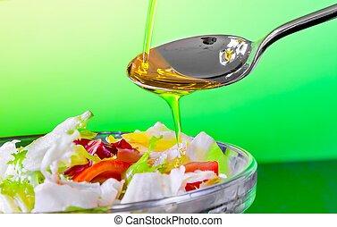 spoon with olive oil on italian fresh salad