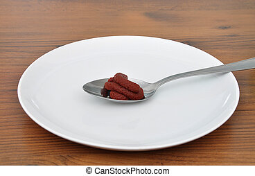 Spoon with tomato puree