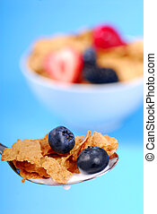 Spoonful of bran flakes with fruit