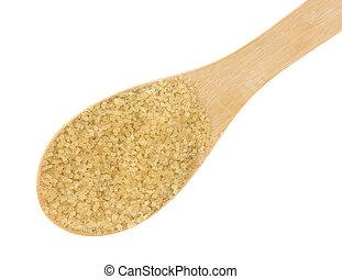Spoonful of turbinado sugar on a white background
