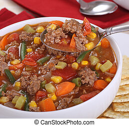 Spoonful of Vegetable Beef Soup - Closeup of a spoonful of...