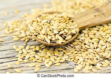 spoonful van, gouden, vlas, zaad, op, hout, achtergrond.