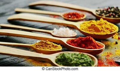 Spoons with assorted spices on a table - Closeup shot of ...