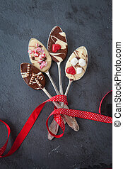 Spoons with chocolate