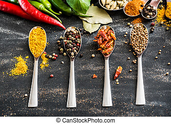 spoons with spices - spoons with different spices and...