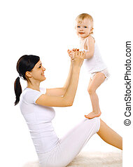 Sport, active, leisure and family concept - happy mom and baby d