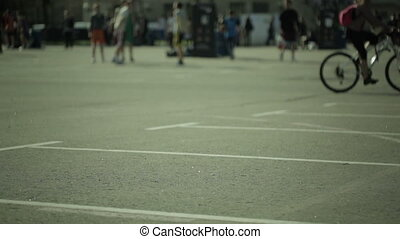Sport activities in a city park. Blured