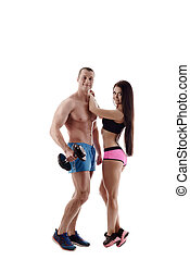Sport and healthy life. Couple posing at camera
