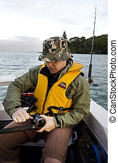 Sport and Recreation - Fishing - A young fisherman on a...
