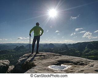 Sport athlete runner man in mountain trail nature