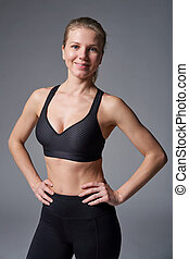 Sport athletic woman standing with hands on hips