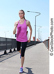 Sport. Attractive girl running on the street