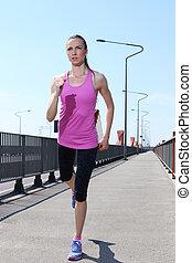 Sport. Attractive girl running on the street