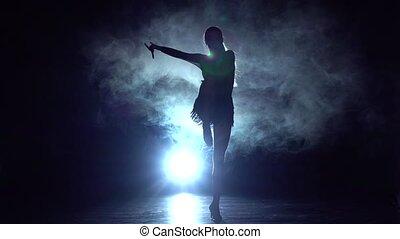 Sport - ballroom dance in the studio, silhouette. Slow motion