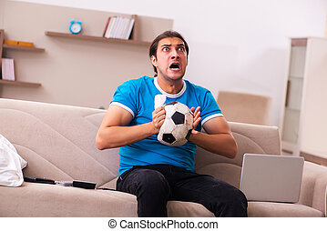 Sport bet addicted man betting at home