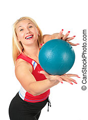 Sport blond makes exercise with ball