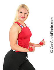Sport blond woman does exercises with dumbbells