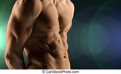 sport, bodybuilding, strength and people concept - cclose up of male bodybuilder bare torso over dark background