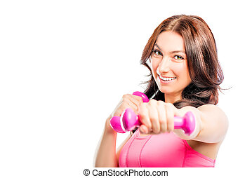 Sport brunette in the studio with pink dumbbells