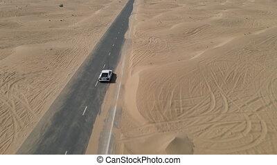 sport car driving on a desert road