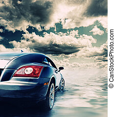 Sport car reflected in water