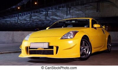 Sport car stand at background of bridge - Yellow sport car...