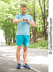 Sport coach. Sport wellbeing and self care. Handsome man sporty outfit look confident. Male beauty. Guy handsome bearded face. Sport is way of life. Sportsman lifestyle. Handsome athlete in park