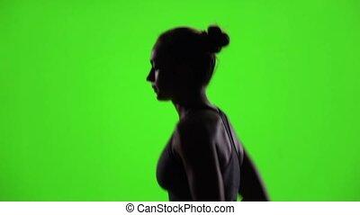 Sport concept. Running girl. Green screen. Slow motion