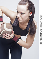 Sport Concepts: Professioanl Female Soccer Player With Ball for American Football.