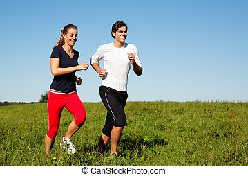 sport couple jogging outdoors in summer - Young fitness ...